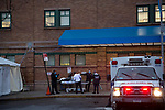 Medical workers attend to a patient arriving by ambulance in front of a triage tent outside of the emergency room at Maimonides Medical Center on March 28, 2020 in Brooklyn, NY.  NYC's daily death toll from the coronavirus nearly tripled from the previous 24-hour period from 85 on Friday to 222 on Saturday.  Photograph by Michael Nagle/Redux