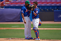 New York Mets pitcher Jeurys Familia (27) talks with catcher James McCann  (33) during a Major League Spring Training game against the Washington Nationals on March 18, 2021 at Clover Park in St. Lucie, Florida.  (Mike Janes/Four Seam Images)