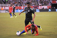 EAST RUTHERFORD, NJ - SEPTEMBER 7: Sergino Dest #18 of the United States battles for the ball with Jesus Manuel Corona #17 of Mexico during a game between Mexico and USMNT at MetLife Stadium on September 6, 2019 in East Rutherford, New Jersey.