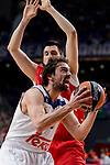 Real Madrid's Sergio Llull and Crvena Zvezda Mts Belgrade's Milko Bjelica during Turkish Airlines Euroleague match between Real Madrid and Crvena Zvezda Mts Belgrade at Wizink Center in Madrid, Spain. March 10, 2017. (ALTERPHOTOS/BorjaB.Hojas)