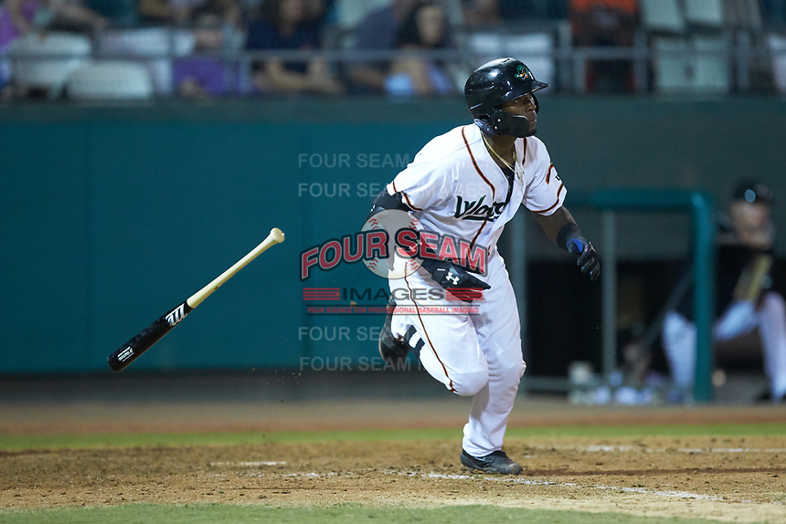 Julio Pablo Martinez (23) of the Down East Wood Ducks tosses his bat as he starts down the first base line against the Winston-Salem Dash at Grainger Stadium Field on May 17, 2019 in Kinston, North Carolina. The Dash defeated the Wood Ducks 8-2. (Brian Westerholt/Four Seam Images)