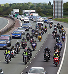 © Joel Goodman - 07973 332324 . 08/05/2011 .  Ellesmere Port, UK . Fuel protesters, including several on motorbikes, drive slowly along the motorway to the protest . An attempted blockade of Stanlow Oil Refinery at Ellesmere Port , Cheshire , in protest at the price of fuel . Organiser Ian Charlesworth says that a 24 pence discount off the price of a litre of petrol is required to bring the UK in line with average European pricing and to keep British businesses competitive . Photo credit : Joel Goodman