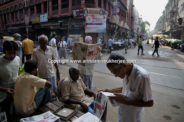 Old Indian men reading newspapers on Chitpur road in Kolkata.West Bengal, India 2009, Arindam Mukherjee