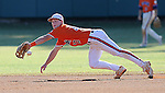 Infielder Mike Dunster (10) of the Clemson Tigers reaches for a grounder in an Orange-Purple fall scrimmage on Oct. 15, 2010, at Doug Kingsmore Stadium in Clemson, S.C. Photo by: Tom Priddy/Four Seam Images
