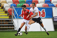 Yael Averbuch defends against Norway during the 2010 Algarve Cup