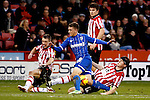 Sheffield United v Gillingham<br /> 16.11.2013<br /> Sky Bet League One.<br /> Picture Shaun Flannery/Trevor Smith Photography<br /> Gillingham's Cody McDonald has his attack halted by United's Tony McMahon and Neill Collins.