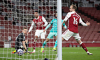 April 3rd 2021; Emriates Stadium, London, England;  Liverpools Mohamed Salah shoots and scores the second goal on 68 minutes during the Premier League match between Arsenal and Liverpool at the Emirates Stadium in London