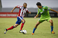CARSON, CA - August 25, 2012: Chivas USA forward Tristan Bowen (20) and Seattle defender Leo Gonzalez (12) during the Chivas USA vs Seattle Sounders match at the Home Depot Center in Carson, California. Final score, Chivas USA 2, Seattle Sounders 6.