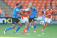 Blackpool's Jerry Yates under pressure from Swindon Town's Diallang Jaiyesimi and Matthew Smith<br /> <br /> Photographer Kevin Barnes/CameraSport<br /> <br /> The EFL Sky Bet League One - Blackpool v Swindon Town - Saturday 19th September 2020 - Bloomfield Road - Blackpool<br /> <br /> World Copyright © 2020 CameraSport. All rights reserved. 43 Linden Ave. Countesthorpe. Leicester. England. LE8 5PG - Tel: +44 (0) 116 277 4147 - admin@camerasport.com - www.camerasport.com