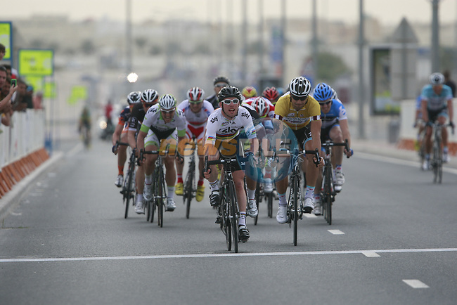 World Champion Mark Cavendish (GBR) Sky Procycling takes the win from yellow jersey holder Tom Boonen (BEL) Omega Pharma-Quick Step as they cross the finish line at the end of Stage 3 of the 2012 Tour of Qatar running 146.5km from Dukhan Souq, Dukhan to Al Gharafa, Qatar. 7th February 2012.<br /> (Photo Eoin Clarke/Newsfile)
