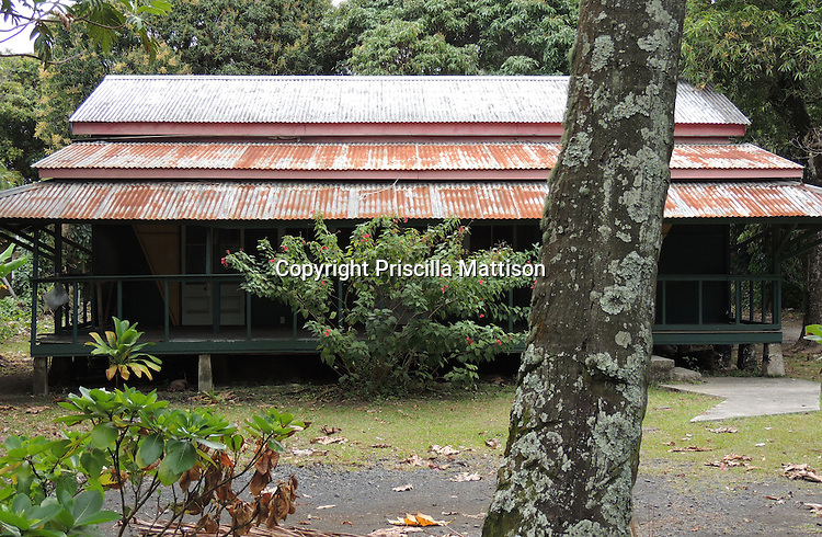 Rarotonga, Cook Islands - September 21, 2012:  A house with a rusty corrugated roof.