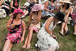 Horse racing at Royal Ascot, Berkshire, England. 2006. Group of young women having fun at the races.