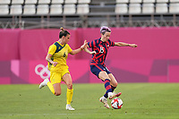 KASHIMA, JAPAN - AUGUST 5: Megan Rapinoe #15 of the United States is marked by Chloe Logarzo #6 of Australia during a game between Australia and USWNT at Kashima Soccer Stadium on August 5, 2021 in Kashima, Japan.