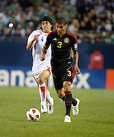 Mexico's Carlos Salcido dribbles the ball while being pursued by Costa Rica's Jose Salvatierra.  Mexico defeated Costa Rica 4-1 at the 2011 CONCACAF Gold Cup at Soldier Field in Chicago, IL on June 12, 2011.