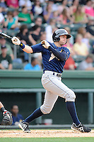 Center fielder Jake Cave (6) of the Charleston RiverDogs bats in a game against the Greenville Drive on Sunday, May 19, 2013, at Fluor Field at the West End in Greenville, South Carolina. Charleston won, 9-7. (Tom Priddy/Four Seam Images)
