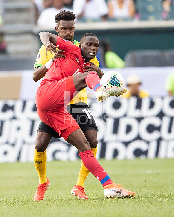 PHILADELPHIA, PA - JUNE 30: Abdiel Arroyo #18 and Shaun Francis #14 vie for the ball during a game between Panama and Jamaica at Lincoln Financial Field on June 30, 2019 in Philadelphia, Pennsylvania.