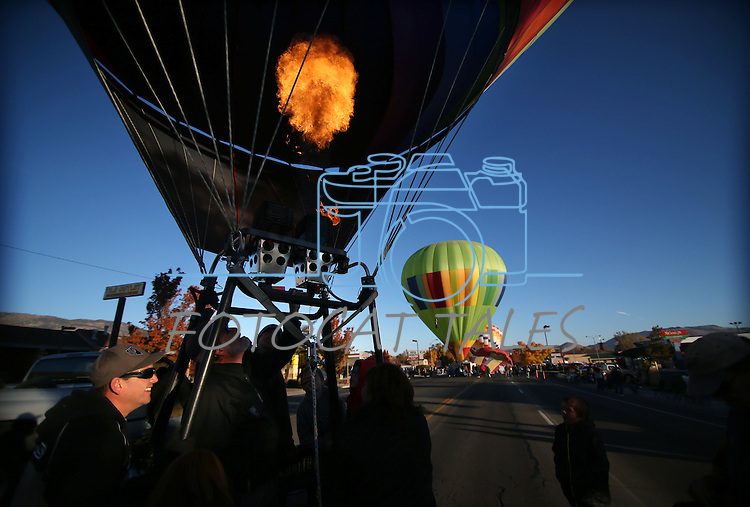 Balloon Nevada pilot Whit Landvater prepares for launch in Carson City, Nev., on Saturday, Oct. 26, 2013, as part of the annual Nevada Day celebration.<br /> Photo by Cathleen Allison