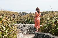 Woman at Pancake Rocks in Punakaiki - Paparoa National Park, West Coast, New Zealand