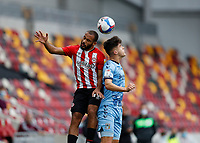 17th October 2020; Brentford Community Stadium, London, England; English Football League Championship Football, Brentford FC versus Coventry City; Said Benrahma of Brentford and Ryan Giles of Coventry City challenge for a header