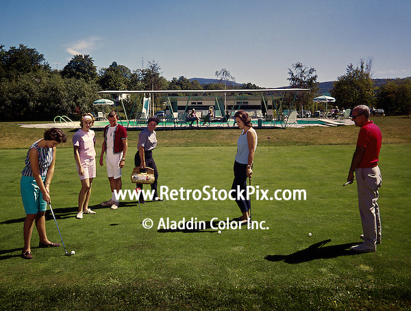 People practicing their putting on the putting green. Windham Arms Resort in the 1960's.