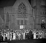 Pittsburgh PA: View of Christmas Services outside the First Luthern Church on Grant Street in Pittsburgh.  Image of Pastor leading the church choir and faithful in song and prayer.  Many of the group were dressed in period clothing at the time of Jesus's birth.