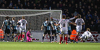 Adam Webster (right) of Portsmouth watches his header level the scores during the Sky Bet League 2 match between Wycombe Wanderers and Portsmouth at Adams Park, High Wycombe, England on 28 November 2015. Photo by Andy Rowland.