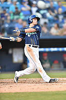 Asheville Tourists third baseman Bret Boswell (3) swings at a pitch during a game against the Greensboro Grasshoppers  at McCormick Field on May 10, 2018 in Asheville, North Carolina. The Tourists defeated the Grasshoppers 9-3. (Tony Farlow/Four Seam Images)