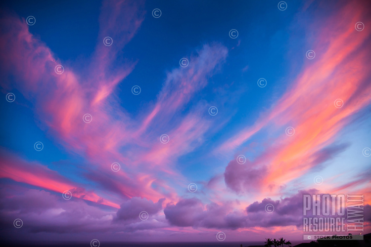 Windswept, vivid clouds top a sunset seen from Hawai'i Loa Ridge, East Honolulu, O'ahu.