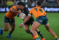 NZ's Richie Mo'unga is tackled during the Bledisloe Cup rugby match between the New Zealand All Blacks and Australia Wallabies at Eden Park in Auckland, New Zealand on Saturday, 7 August 2021. Photo: Dave Lintott / lintottphoto.co.nz