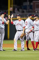 Mookie Betts (12) of the Pawtucket Red Sox high fives teammates following their win over the Charlotte Knights at BB&T Ballpark on August 9, 2014 in Charlotte, North Carolina.  The Red Sox defeated the Knights  5-2.  (Brian Westerholt/Four Seam Images)