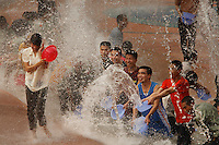 Water Fight at China Folk Culture Villages.  This is mimicking a once a year ceremony from the minority group Dai Zuo. August 1 is Armed Services Day in China, so the military got into the park for free...Main Contact for Shenzhen is: Susanne.shu@gmail.com Or Susanne.shu@hotmail.com  (+86 138 252 13872) Susanne is main fixer in Shenzen.  .