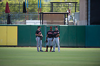 San Jose Giants outfielders Logan Baldwin (1), Heliot Ramos (13), and Bryce Johnson (23) talk during a pitching change in a California League game against the Stockton Ports on April 9, 2019 in Stockton, California. San Jose defeated Stockton 4-3. (Zachary Lucy/Four Seam Images)