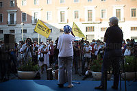 """Emma Bonino MP & Luigi Manconi.<br /> <br /> Rome, 27/07/2020. Today, hundreds of people, NGO's (ONG) representatives, actors and politicians gathered in Piazza San Silvestro (near the Italian Parliament) to protest (1.) against the dramatic situation in Libya - erupted in a civil war between the GNA (2.) and the forces of General Khalifa Belqasim Haftar - and to protest against the inhumane conditions of migrant people trapped in legal and illegal prisons in Libya. The aim of the demo was to call the Italian Government to stop funding the """"Libyan Coast Guard"""" and to immediately help and free People in Libya throughout """"Humanitarian Corridors"""", and give them the protection they are entitled of by the International Human Rights Conventions. <br /> From the organisers Facebook event page: «[…] we meet to ask the Italian Government and the European States to stop funding the so-called Libyan coast guard, to close and evacuate the detention centres by transferring migrants out of Libya and to promote corridors to help people on the run find protection without endangering their lives. The men, women and children who take the sea from the Libyan coast flee from situations of extreme misery, despotic regimes, tribal persecutions, ethnic conflicts, wars and environmental catastrophes. And in Libya they are subjected to violence, extortion, detention, torture, rape and torture. A few days ago, on July 16, the Chamber of Deputies [Of the Italian Parliament, ndr] for the fourth consecutive year approved the financing of the Italian mission in Libya, which provides financial support for the so-called Libyan coastguard and training and training of its members. […] The mobilization will be accompanied by readings by Ascanio Celestini, Valentina Carnelutti, Fabrizio Gifuni and Sonia Bergamasco […]».<br /> <br /> Footnotes & Links:<br /> 1. https://www.facebook.com/events/2732849460337428/<br /> 2. 07.05.19 Prime Minister of Libya Fayez al-Serraj Met Italian PM Giuseppe Conte at Pa"""