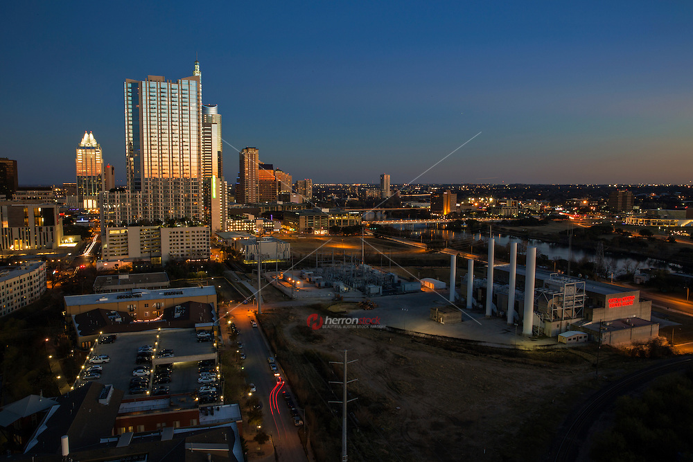 A view of the ever expanding Austin Skyline and inset the retro City of Austin Seaholm Power Plant at sunset. Austin, Texas Downtown Real Estate Market Conditions face explosive growth projected for 2013.
