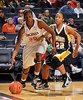 Dec. 18, 2010; Charlottesville, VA, USA; Virginia Cavaliers forward Telia McCall (30) drives past UMBC Retrievers guard Kristin Coles (22) during the game at the John Paul Jones Arena. Virginia won 61-46. Mandatory Credit: Andrew Shurtleff