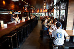 Diners at Momofuku Ssam Bar at 207 Second Avenue at 13th Street in the East Village eat lunch, New York City.