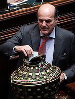 Il leader del Partito Democratico Pierluigi Bersani vota durante la prima seduta comune di senatori e deputati per l'elezione del nuovo Capo dello Stato alla Camera dei Deputati, Roma, 18 aprile 2013..Italian Democratic Party's leader Pierluigi Bersani votes during the first common plenary session of senators and deputies to elect the new Head of State, at the Lower Chamber in Rome, 18 April 2013..UPDATE IMAGES PRESS/Riccardo De Luca.