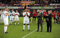 (L-R) Alan Tate is aplauded by former Swansea managers Roberto Martinez, Brendan Rodgers and Brian Flynn (R) during the Swansea Legends v Manchester United Legends at The Liberty Stadium, Swansea, Wales, UK. Wednesday 09 August 2017