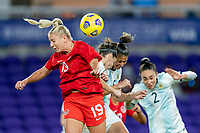 ORLANDO, FL - FEBRUARY 21: Adriana Leon #19 of Canada heads the ball during a game between Canada and Argentina at Exploria Stadium on February 21, 2021 in Orlando, Florida.