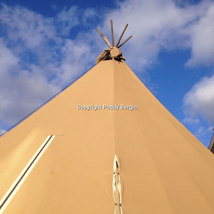 Wigwam set up on the South Bank, London outside the Royal Festival Hall.<br /> <br /> A wigwam, wickiup or wetu is a domed dwelling formerly used by certain Native American and First Nations tribes, and still used for ceremonial purposes.<br /> <br /> Stock Photo by Paddy Bergin