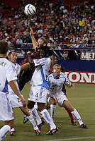 The MetroStars' Jeff Parke goes up for a header with the Wizard's Davy Arnaud and Shavar Thomas as teammates Jack Jewsbury, Jimmy Conrad, and the MetroStars' Eddie Pope watch. The Kansas City Wizards were defeated by  the NY/NJ MetroStars to a 1 to 0 at Giant's Stadium, East Rutherford, NJ, on May 30, 2004.