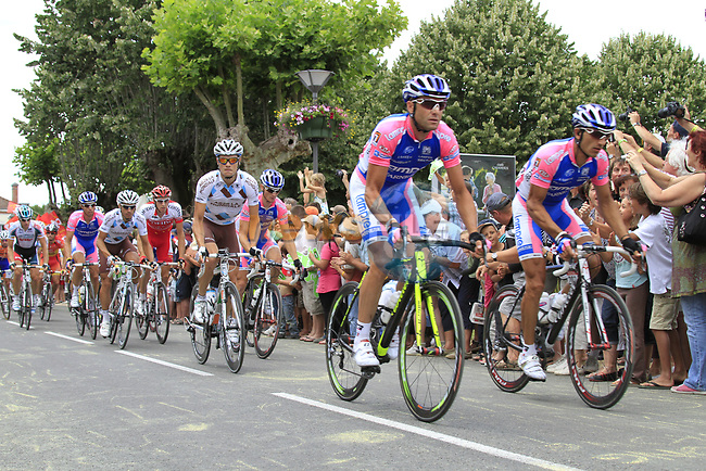 The peloton including Nicolas Roche (IRL) AG2R La Mondiale pass through the village of Sabres during Stage 18 of the 2010 Tour de France running 198km from Salies-de-Bearn to Bordeaux, France. 23rd July 2010.<br /> (Photo by Eoin Clarke/NEWSFILE).<br /> All photos usage must carry mandatory copyright credit (© NEWSFILE | Eoin Clarke)