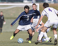 Brandeis forward Zach Vieira (3) battle for the ball.  NCAA Division III Sectionals. Williams College (white) defeated Brandeis University (blue/white), 2-0, on Hitchcock Field at Amherst College on November 23, 2013.