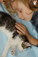 Girl (5-7) sleeping by kitten, close-up, elevated view (Licence this image exclusively with Getty: http://www.gettyimages.com/detail/200502995-001 )