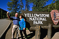 Tourist couple having fun with camera at Yellowstone National Park in Wyomin