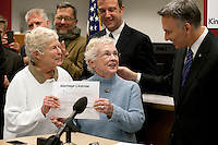One month after Washington State voters approved the state's marriage equality law in Ref. 74, couples lined up to get marriage licenses on December 6th, 2012. Shortly after midnight, King County Executive Dow Constantine, right, began to issue marriage licenses to same-sex couples. First in line are Jane Abbott Lighty, 77, left, and Pete-e Petersen, 85. The couple has been together for 35 years and live in West Seattle. They are getting married on Dec 9th, the first day it is possible for same-sex couple to wed in Washington State.