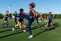 KASHIMA, JAPAN - AUGUST 4: Casey Krueger #20 of the USWNT warms up during a training session at the practice field on August 4, 2021 in Kashima, Japan.