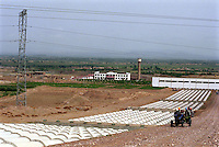 Power and water are imported  to the Hong Si Pu Resettlement Farmland, Zhong Ning. Ning Xia, China. Droughts and desertification are causing serious environmental problems in China...WONG / SINOPIX.
