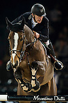 Roger-Yves Bost of France rides Nippon d'Elle in action at the Longines Grand Prix during the Longines Hong Kong Masters 2015 at the AsiaWorld Expo on 15 February 2015 in Hong Kong, China. Photo by Juan Flor / Power Sport Images
