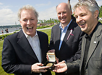 Jean Leclerc, chairman of the board of the Societe du 400e anniversaire de Quebec (center) and Daniel Gelinas, President and Director General of the Societe du 400e anniversaire de Quebec (right), laugh as they present a gift to Quebec Premier Jean Charest, left at the inauguration of the Promenade Samuel-de-Champlain Tuesday June 24, 2008 in Quebec City. The Promenade, a 2.5km parkway along the St-Lawrence River, is the gift from the government of Quebec to Quebec city for her 400th's birthday<br /> <br /> PHOTO :  Francis Vachon - Agence Quebec Presse